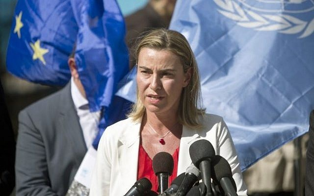 The European Union's new foreign affairs chief Federica Mogherini speaks as she visits the UN-run Bahrain boys school on November 8, 2014 in Gaza City. (AFP PHOTO/MAHMUD HAMS)