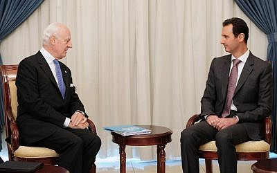 A picture released by the Syrian Arab News Agency (SANA) shows Syrian President Bashar al-Assad (R) meeting with United Nations special envoy for Syria Staffan de Mistura in Damascus on November 10, 2014. (Photo Credit: AFP PHOTO/HO/ SANA)
