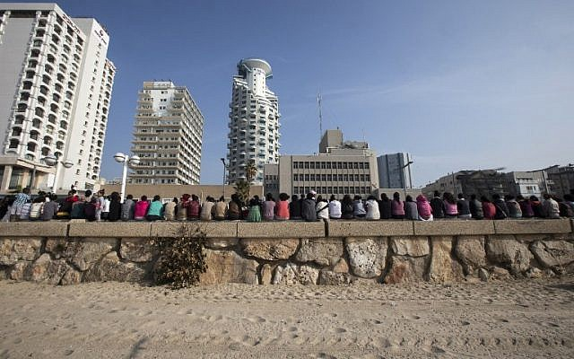A picture taken on January 15, 2014 shows African asylum seekers , who entered Israel illegally via Egypt, staging a protest along the sea front in Tel Aviv, after days of mass protests against Israel's immigration policies. (photo credit: AFP/JACK GUEZ/File)