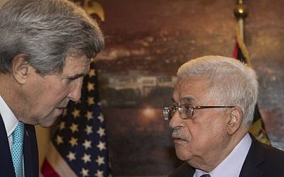 US Secretary of State John Kerry (L) meets with Palestinian Authority President Mahmoud Abbas at the latter's residence in Amman on November 13, 2014 (photo credit: AFP/POOL/Nicholas Kamm)