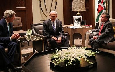 A handout picture released by the Jordanian Royal Palace shows Jordan's King Abdullah II (R) during a trilateral meeting with Israeli Prime Minister Benjamin Netanyahu (C) and US Secretary of State John Kerry in Amman on November 13, 2014. (Photo credit: AFP/JORDANIAN ROYAL PALACE/ HO / YOUSEF ALLAN)