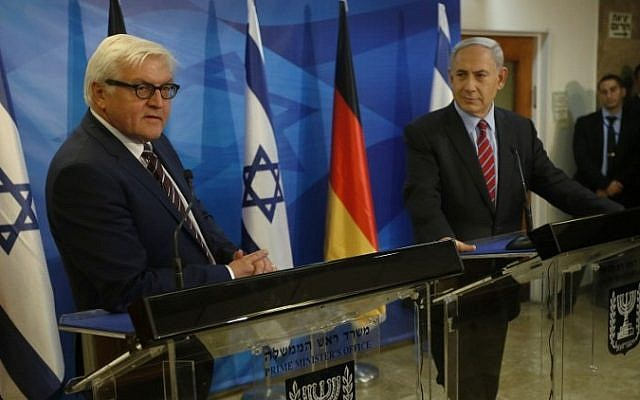 Prime Minister Benjamin Netanyahu and Germany's Foreign Minister Frank-Walter Steinmeier deliver joint statements to the media before their meeting in Jerusalem on November 16, 2014. (Photo credit: AFP  / POOL / RONEN ZVULUN)