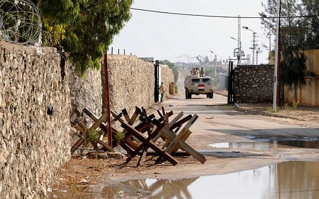 An Egyptian army vehicle patrols along the border with the Hamas-run Gaza Strip in the divided border town of Rafah on November 4, 2014. (Mohamed El-Sherbeny/AFP)