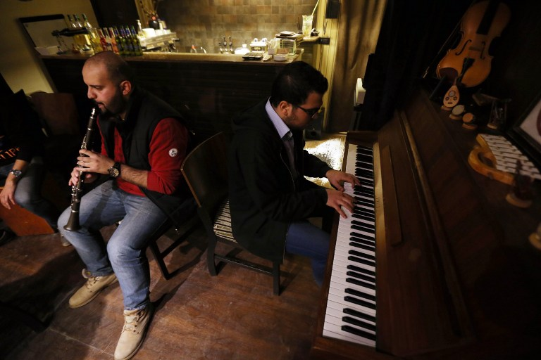 Syrian musicians perform at a pub restaurant in Aleppo in the government controlled side of the war-torn northern Syrian city on November 17, 2014 (photo credit: AFP/JOSEPH EID)