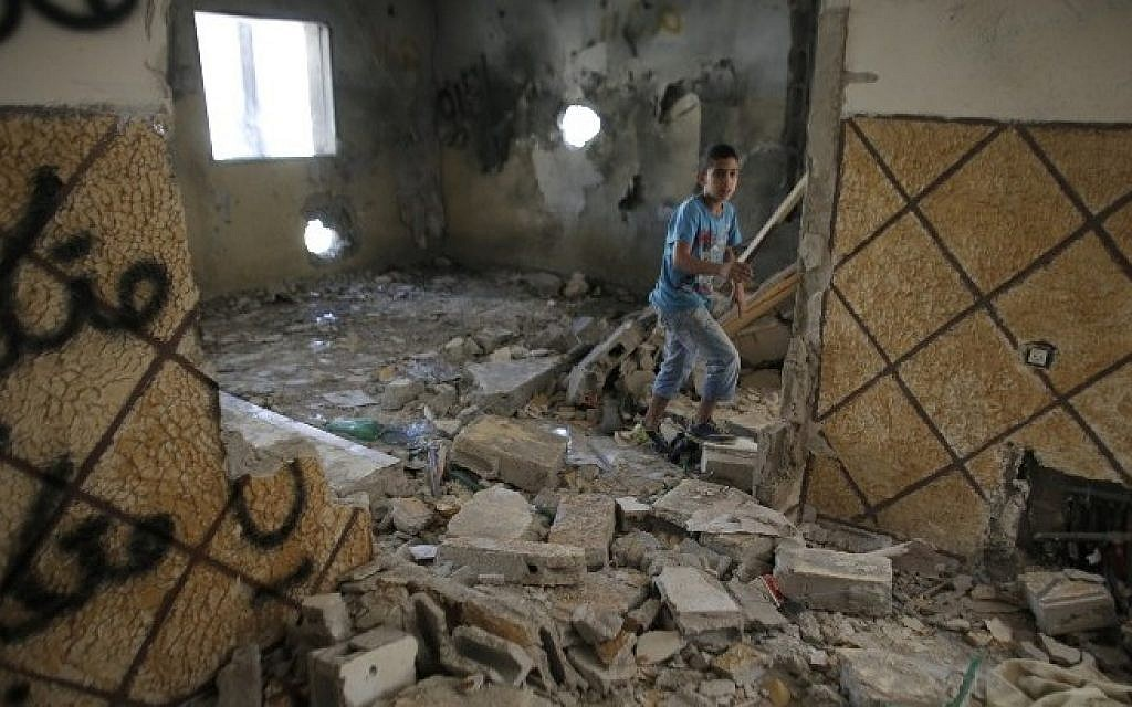 The home of Palestinian terrorist Abdelrahman al-Shaludi in East Jerusalem after it was destroyed by Israeli authorities on November 19, 2014. (AFP/Ahmad Gharabli)