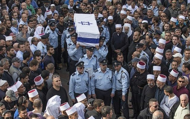 Israeli police officers carry the coffin of their comrade Zidan Saif, 30, a member of Israel's Druze minority killed in a terror attack, during his funeral in his northern home village of Yanuh-Jat, on November 19, 2014.  (photo credit: AFP/JACK GUEZ)
