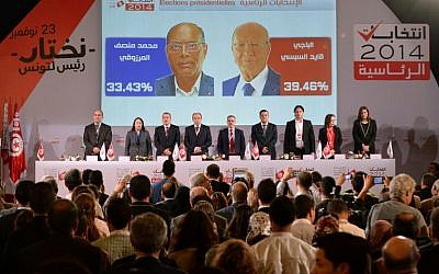 Members of the Tunisian ISIE elections body hold a press conference to announce the results of the first round of the presidential election on November 25, 2014. (photo credit: AFP/FADEL SENNA)