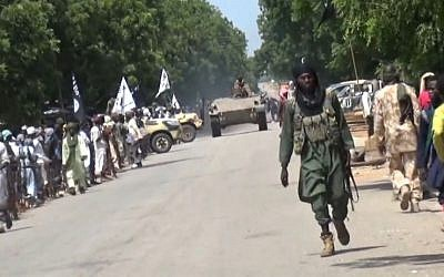 File: A screen capture taken on November 9, 2014 from a new video released by the Nigerian Islamist extremist group Boko Haram and obtained by AFP shows Boko Haram fighters parading with a tank in an unidentified town. (AFP/HO/Boko Haram)