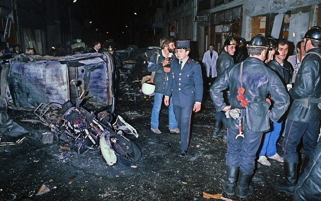 A file picture taken on October 3, 1980 shows firefighters standing by the wreckage of a car and motorcycle after a bomb attack at a Paris synagogue on Rue Copernic which killed four people. (Photo credit: AFP)