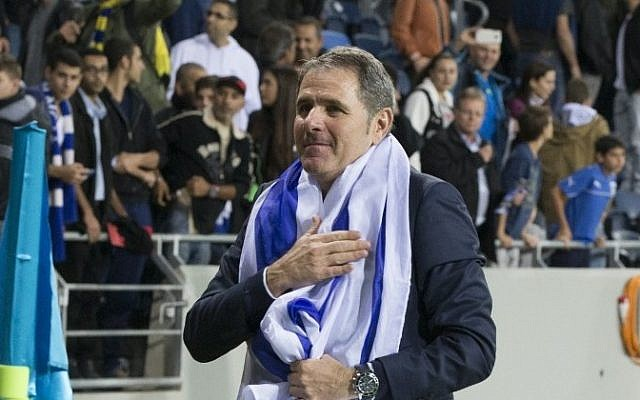 Israel's head coach Elie Guttman celebrates after his team won the UEFA 2016 European Championship qualifying group B football match between Israel and Bosnia-Herzegovina at the Sammy Ofer Stadium, on November 16, 2014 in Haifa. (Photo credit: AFP/ JACK GUEZ)