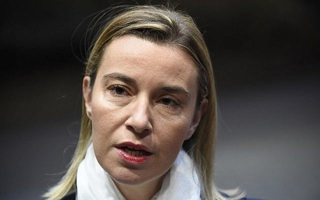 European Union's foreign policy chief, Federica Mogherini, speaks to journalists as she arrives for a Foreign Affairs Council meeting at the EU Headquarters in Brussels, on November 17, 2014. (photo credit: AFP/JOHN THYS)