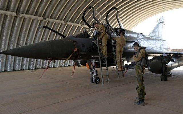 Pilots from the French Air Forces detachment (DETAIR) are pictured next to a Mirage 2000D fighter jet at the Air Base 101, on November 23, 2014 in Niamey. (photo credit: AFP/MIGUEL MEDINA)