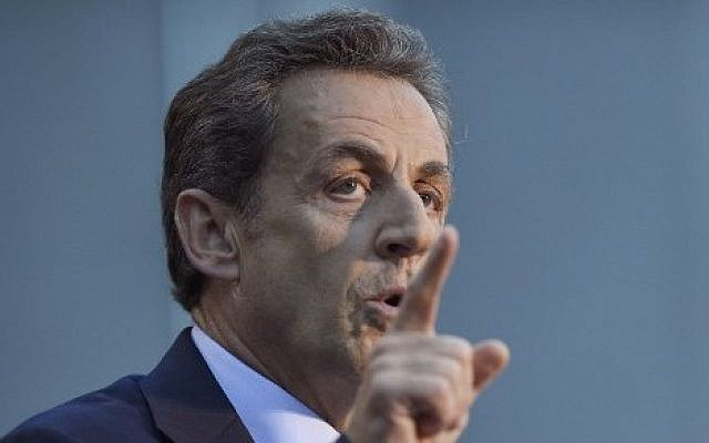 Former French president and candidate for the presidency of French right-wing main opposition party UMP Nicolas Sarkozy gestures as he speaks during a meeting in Boulogne-Billancourt, a Paris suburb, on November 25, 2014. (photo credit: AFP PHOTO / MARTIN BUREAU)
