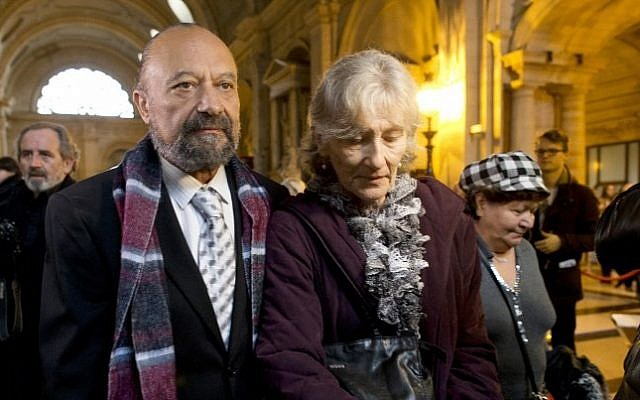 The parents of Lee Zeitouni, who was killed in a hit-and-run in 2011, arrive at the courthouse in Paris, November 27, 2014. (photo credit: AFP/Kenzo Tribouillard)