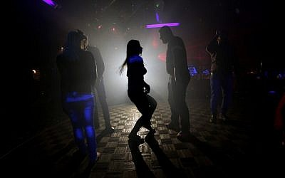 A file picture taken on November 15, 2014, shows Syrians dancing at a night club in the government-controlled part of the northern city of Aleppo (phoro credit: AFP/JOSEPH EID)