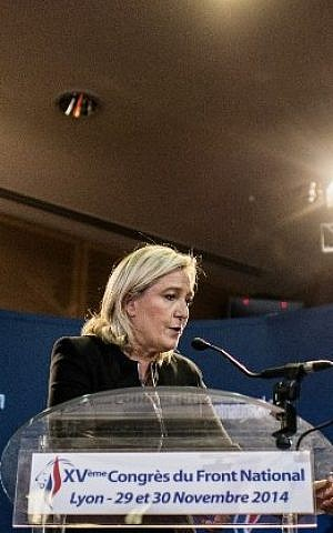 France's far-right National Front (FN) party's leader Marine Le Pen delivers a speech in front of journalists, on November 29, 2014 in Lyon, during the 15th congress of the party. (photo credit: AFP/JEFF PACHOUD)