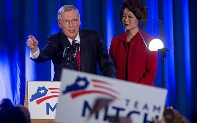 US Sen. Mitch McConnell (R-KY) speaks accompanied by his wife Elaine Chao at his election night event November 4, 2014 in Louisville, Kentucky (Photo credit: Aaron P. Bernstein/Getty Images/AFP)