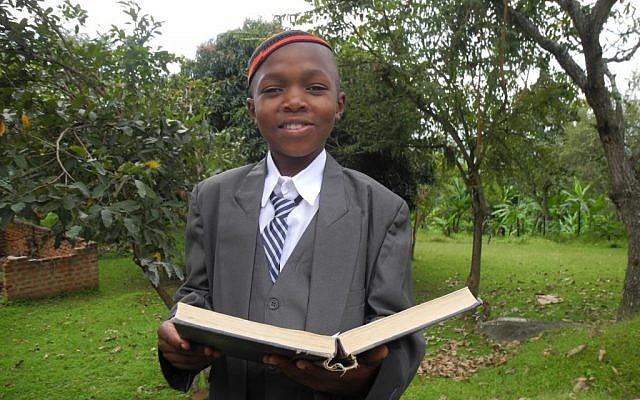 Keki's son Aaron took over the Luganda translation duties from his father for the mass Bar Mitzvah. (Melanie Lidman/Times of Israel)