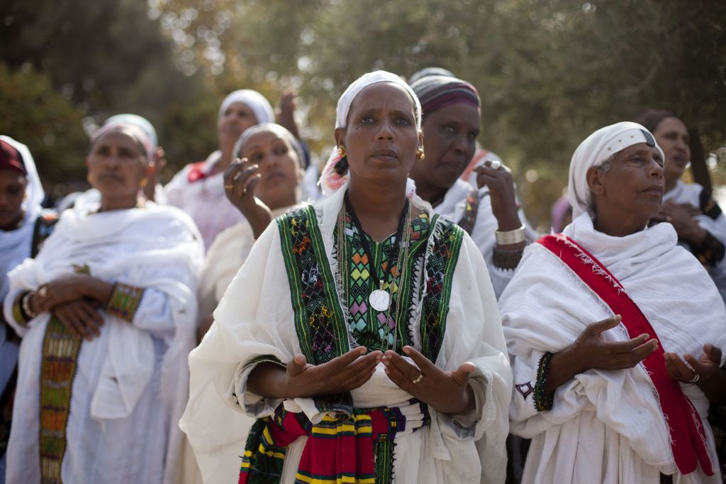 Sigd celebrants usually dress in white to symbolize purity and the acceptance of the Torah (photo credit: Flash 90)