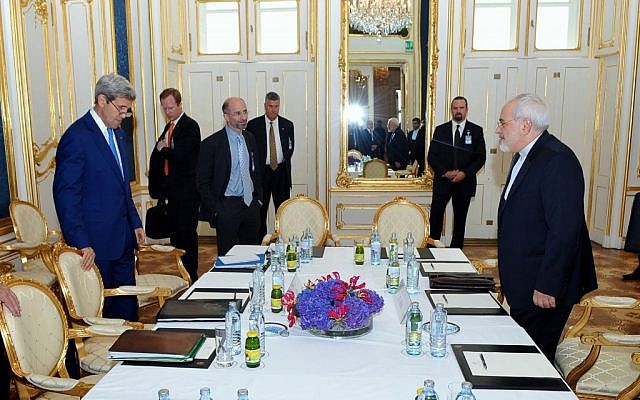 US Secretary of State John Kerry prepares to sit down with Iranian Foreign Minister Mohammad Javad Zarif in Vienna, Austria, on July 14, 2014. (photo credit: US State Department)