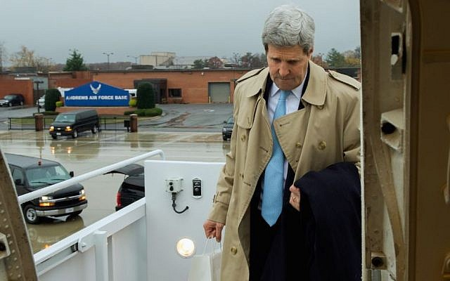 US Secretary of State John Kerry boards his aircraft in the rain at Andrews Air Force Base in suburban Washington on November 17, 2014, en route to London, United Kingdom, and Vienna, Austria, for talks about the future of Iran's nuclear program and other international issues. (photo credit: State Department/ Public Domain)