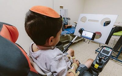 A young paralyzed boy uses the Sesame Enable phone (Courtesy)