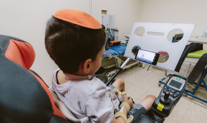 A young paralyzed boy uses the Sesame Phone (Photo credit: Courtesy)