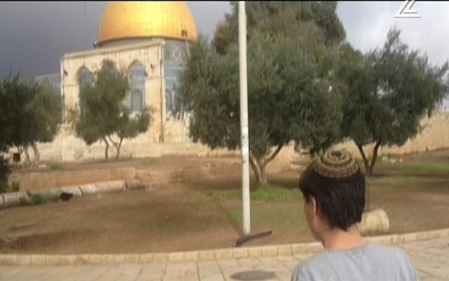 Shahar Glick, son of the wounded Temple Mount activist Yehudah Glick, visits the site deemed holy to Jews and Muslims alike, on November 3, 2014. (Channel 2/screen capture)