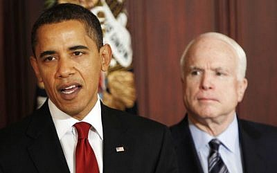 In this March 4, 2009 file photo, Sen. John McCain, R-Ariz., looks on as President Barack Obama makes remarks on government contracts reform in the Eisenhower Executive Office Building on the White House campus in Washington. (photo credit: AP Photo/Gerald Herbert, File)