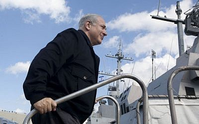 Prime Minister Benjamin Netanyahu boards the INS Eilat, on a visit to Haifa, Nov. 17, 2009. (photo credit: AP Photo/ Pavel Wolberg, Pool)