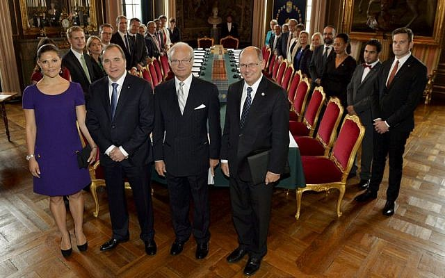 Sweden's new government posing together with front from left, Crown Princess Victoria, Prime Minister Stefan Lofven, King Carl Gustaf and parliament speaker Urban Ahlin, Oct. 3, 2014. (photo credit: AP Photo/Anders Wiklund)