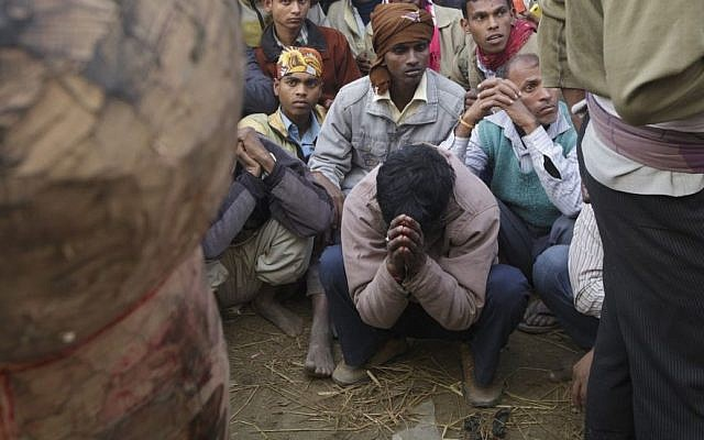 In this photo, a man prays prior to the first sacrifice of buffalo during the Gadhimai Festival in Bara, Nepal on Friday, November 28, 2014. (Photo credit: Kuni Takahashi/AP Images for Humane Society International)