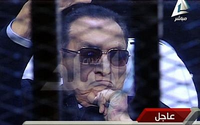 Ousted Egyptian President Hosni Mubarak sits in the defendant cage during his trial at a court in Cairo, Egypt, Saturday, Nov. 29. (Photo credit: AP/Sada el-Balad via Egypt's State Television)