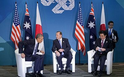 US President Barack Obama, left, Australian Prime Minister Tony Abbott, center, and Japanese Prime Minister Shinzo Abe, right, at the start of their meeting at the G20 Summit in Brisbane, Australia, Sunday, November 16, 2014. (photo credit: AP/Pablo Martinez Monsivais)