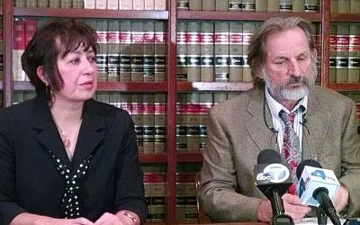 Sandra Troian (left) with her attorney Dan Stormer talks during a news conference in Pasadena, California, on Thursday, November 13, 2014. (photo credit: AP/Christopher Weber)