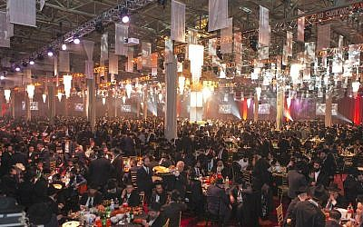 This year's Chabad emissaries' conference commemorates 20 years to the death of Chabad founder Rebbe Schneerson and took place on Sunday November 23, 2014 in a warehouse in New York. (Adam Ben Cohen / Chabad.org)