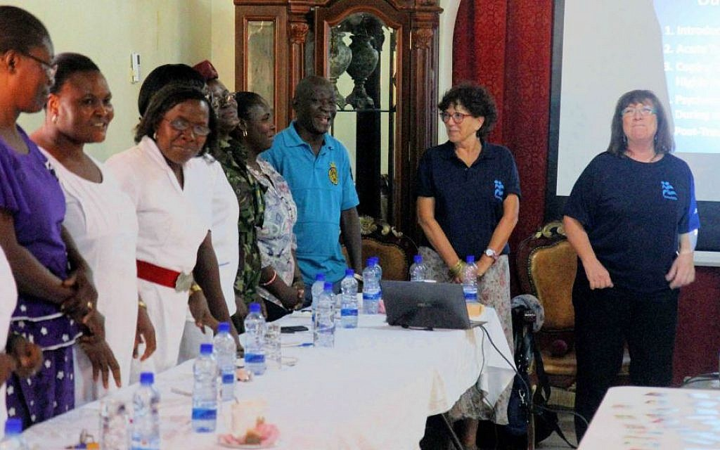 IsraAID psychosocial trauma specialists Hela Yaniv (left), and Sheri Oz leading a counseling and training session for service providers in Sierra Leone, on October 27, 2014. (photo credit: Courtesy IsraAID/JTA)