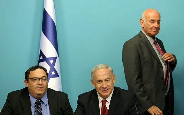 Prime Minister Benjamin Netanyahu flanked by Yesh Atid's Minister of Education Shay Piron (left) and Minister of Science Yaakov Peri, at the Prime Minister's office in Jerusalem on June 30, 2013. (Photo credit: Marc Israel Sellem/POOL/FLASH90