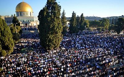 Thousands of Palestinians pray outside Al-Aqsa Mosque, atop the Temple Mount in Jerusalem's Old City, on the Muslim holiday of Eid Al Adha in October 2014. (Sliman Khader/FLASH90)