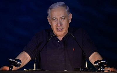 Prime Minister Benjamin Netanyahu speaks during an opening ceremony of the tunnel along the route of the express train between Jerusalem and Tel Aviv, on October 6, 2014. (Photo credit: Haim Zach/GPO)