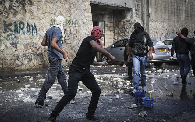 Palestinian youth clash with Israeli police in East Jerusalem, October 30, 2014. (photo credit: Hadas Parush/ Flash90)