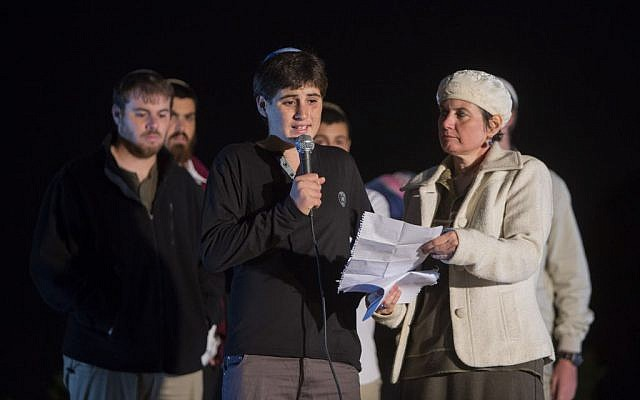 The son and wife of Yehudah Glick speak during a prayer rally at Safra Square in Jerusalem on November 1, 2014. (Photo credit: Yonatan Sindel/Flash90)