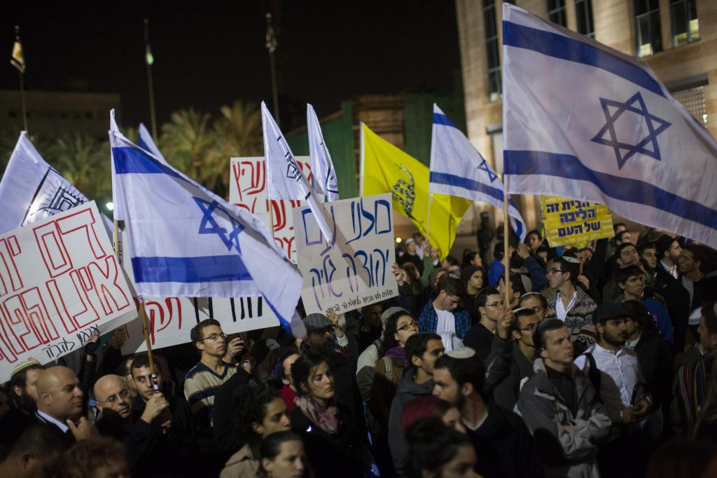 Israelis participate in a prayer rally for Yehudah Glick at Safra Square in Jerusalem on November 1, 2014. Glick is hospitalized after being shot on October 29, allegedly by a Palestinian would-be assassin. (Photo credit: Yonatan Sindel/Flash90