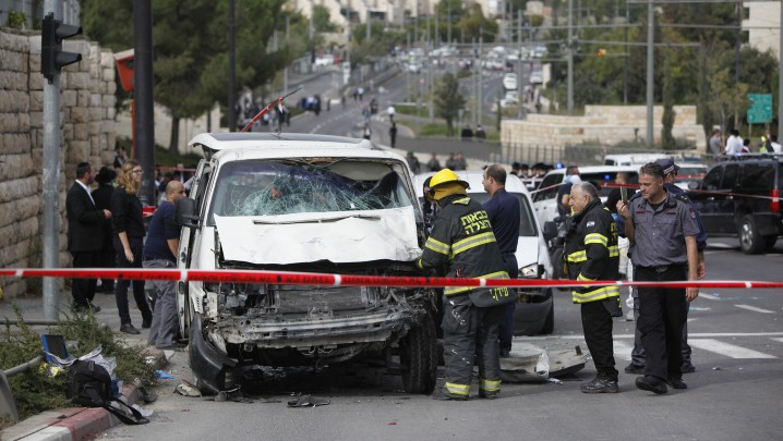 Israeli security personnel at the site where an Arab man from the East Jerusalem neighborhood of Shuafat drove his car into a crowd of people waiting at a light rail station in Jerusalem, November 05, 2014. (photo credit: Yonatan Sindel/FLASH90)
