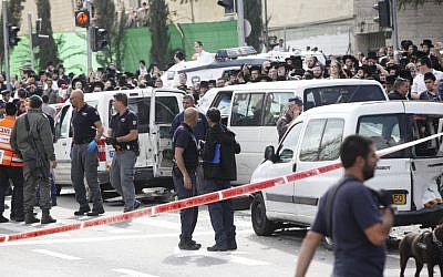 Israeli security personnel at the site where an Arab man from the East Jerusalem neighborhood of Shuafat drove his car into a crowd of people waiting by the Shimon ha Tzadik light rail station in Jerusalem injuring at least 8 people, and killing one bystander, November 05, 2014. (photo credit: Yonatan Sindel/FLASH90)