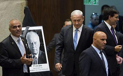 Prime Minister Benjamin Netanyahu arrives at a Knesset memorial session marking 19 years since the assassination of Yitzhak Rabin, November 5,2014. (Photo credit: Yonatan Sindel/Flash90)