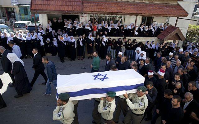 Thousands attend the funeral of slain Israeli Border Police officer Jedan Assad, in the northern Druze village of Beit Jann, on November 06, 2014. (Photo credit: FLASH90)