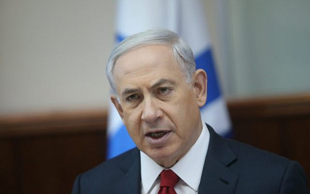 Prime Minister Benjamin Netanyahu speaks during the weekly cabinet meeting on Sunday, November 9, 2014. (photo credit: Alex Kolomoisky/POOL)