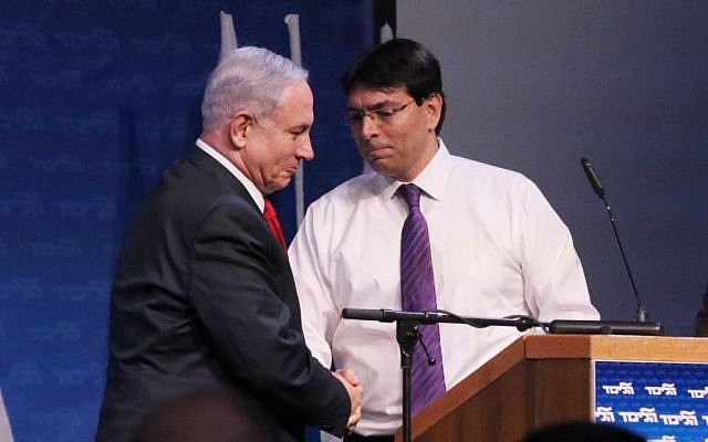 Likud MK Danny Danon (R) and Prime Minister Benjamin Netanyahu seen at the Likud party conference at Airport City conference center near the city of Modiin on November 9, 2014. (photo credit: Flash90)
