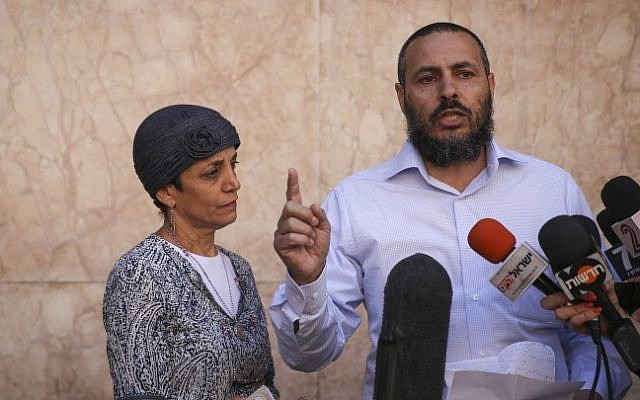 The parents of injured IDF soldier Moshe Aharoni speak to the media outside the Hadassah Ein Kerem hospital emergency unit where Moshe is hospitalized, on November 9, 2014. (photo credit: Hadas Parush/Flash90)